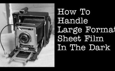 How Do I Handle Large Format Sheet Film in the Dark?